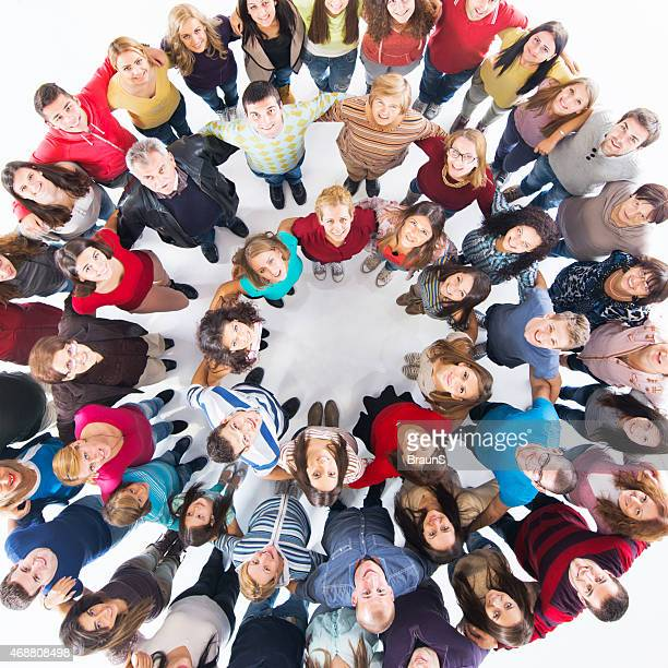 Above view of embraced group of people in a circle.