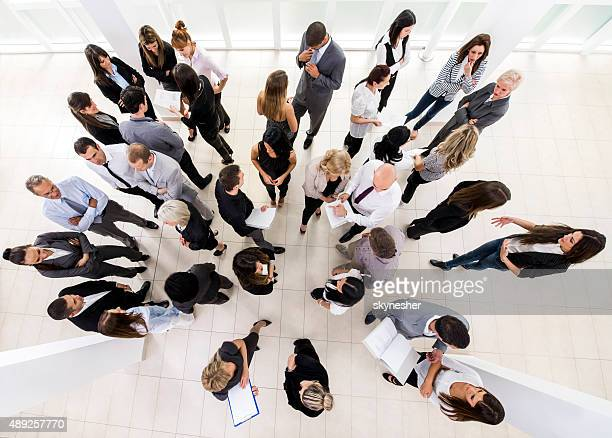 Above view of group of business people communicating.