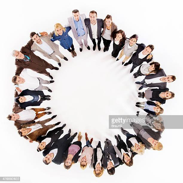 Above view of group of happy embraced business colleagues.