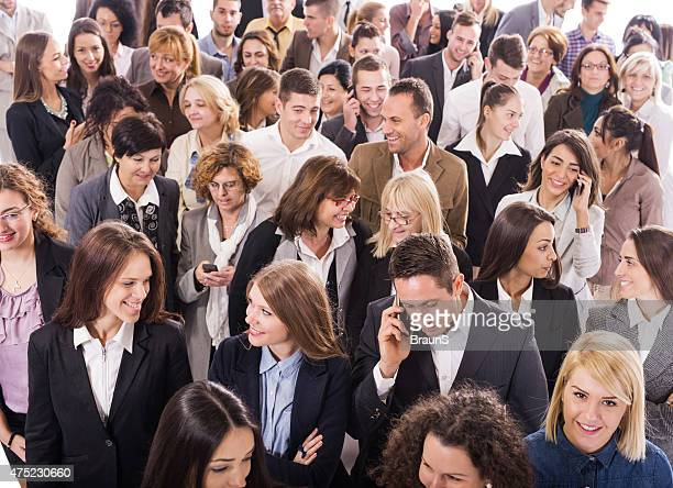 Above view of group of multi-tasking business people.