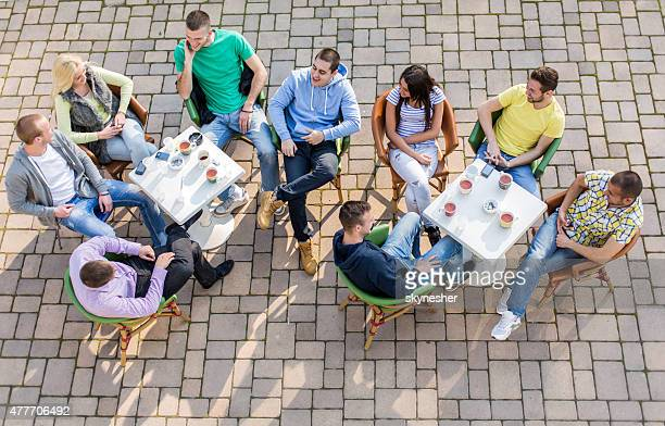 Above view of group of young people relaxing in cafe.