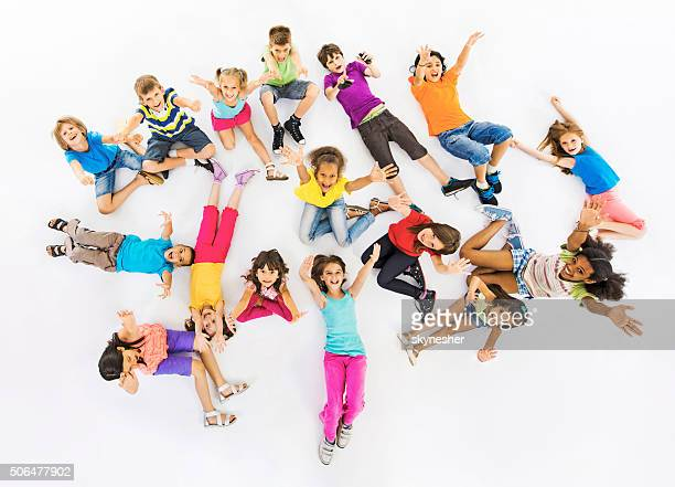 Above view of happy children with hands raised.