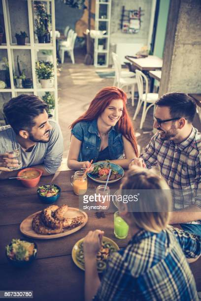 above view of happy friends having lunch together and communicating. - the brunch stock pictures, royalty-free photos & images