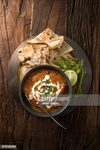 above view of indian chicken curry meal. - north indian food stock photos and pictures