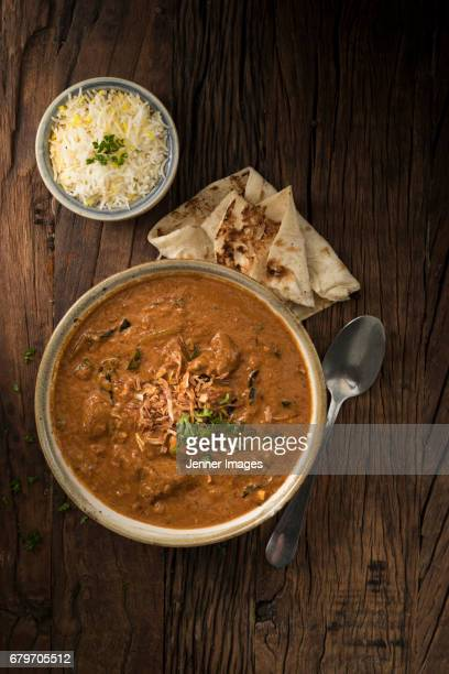 above view of lamb curry, garnished with herbs. - north indian food stock photos and pictures