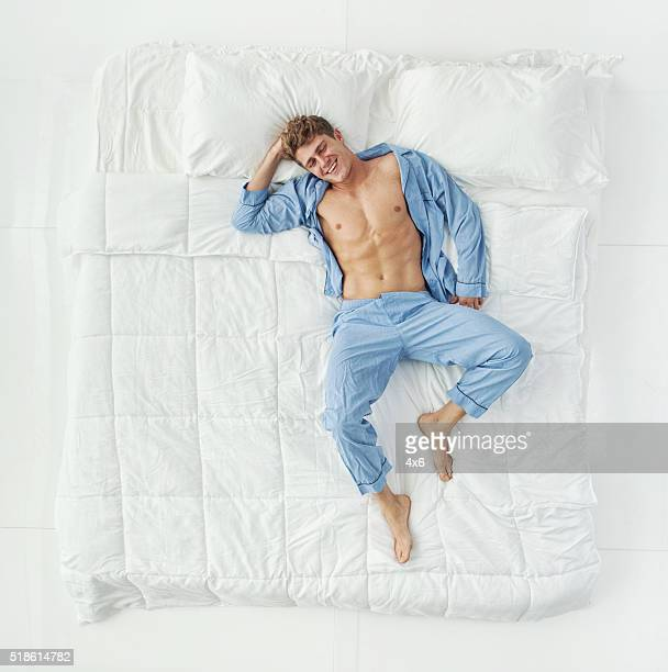 Above view of man lying on bed