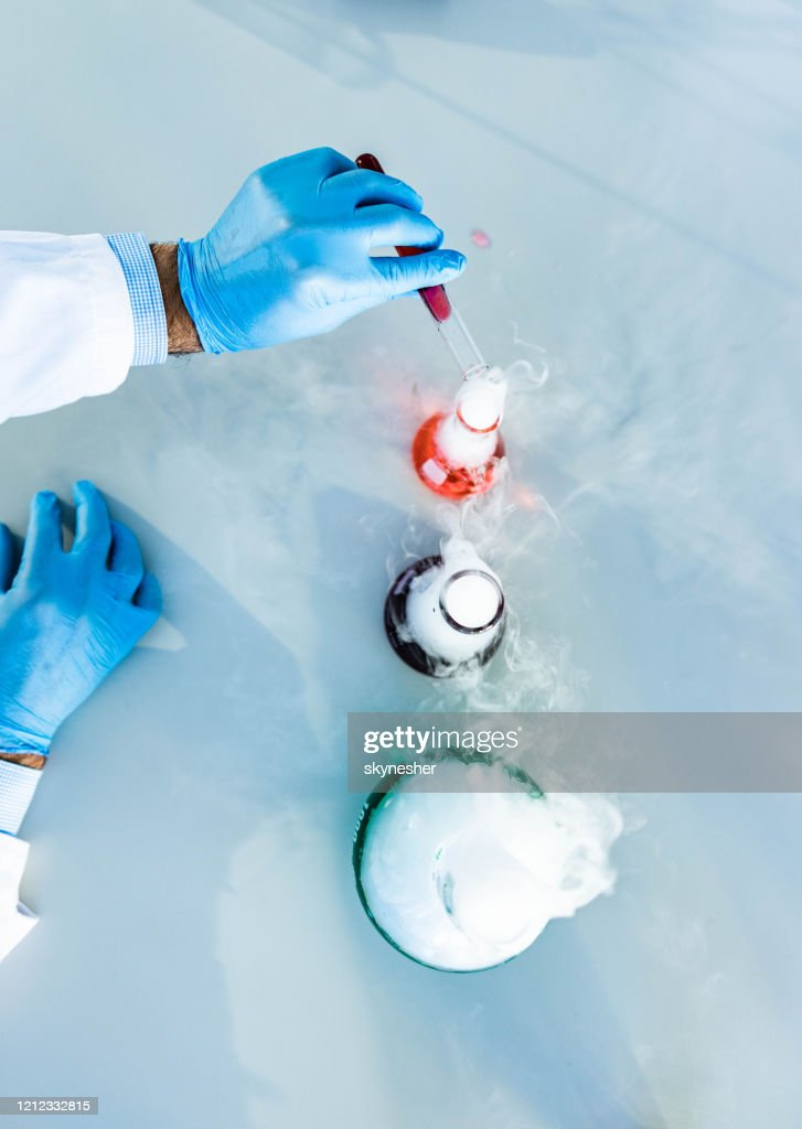 Above view of mixing poisonous chemical liquids in laboratory. : Stock Photo