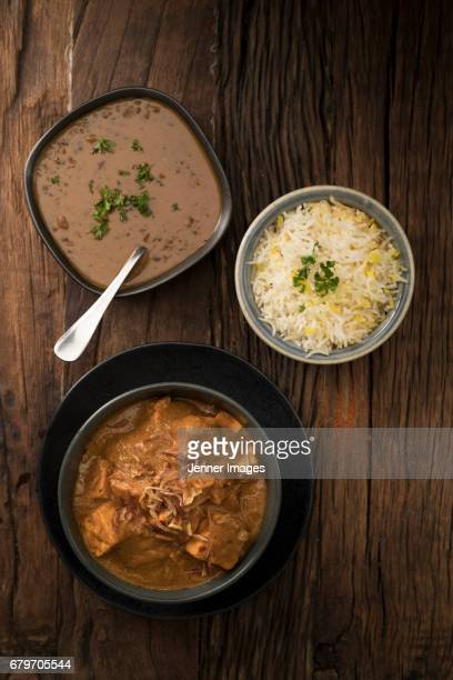 above view of paneer butter masala, dal makhani and rice. - north indian food stock photos and pictures