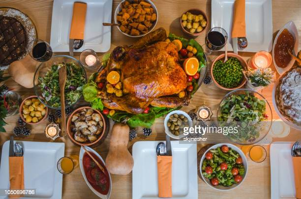 above view of place setting on thanksgiving day. - thanksgiving table stock photos and pictures