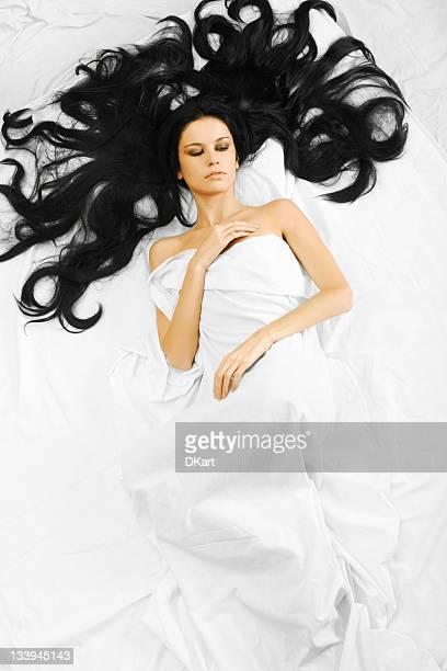 Above view of sleeping beautyful brunet girl