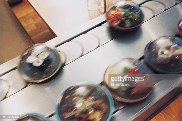 Above View of Sushi Meals in Containers on a Conveyor Belt