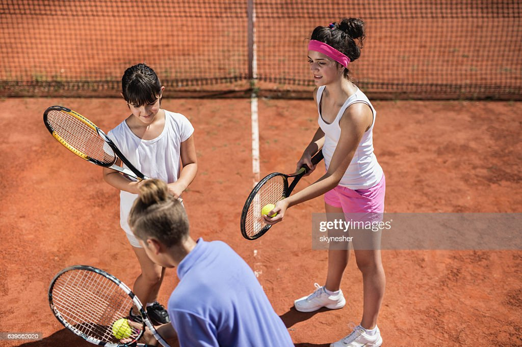 Above view of three kids playing tennis together. : Stock Photo