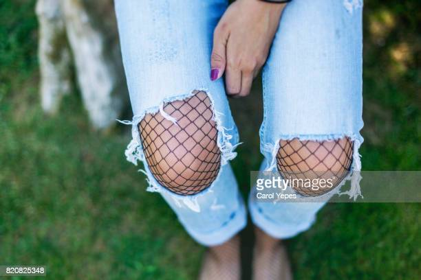 above view of young wearing torn denim trousers - innocence fotografías e imágenes de stock