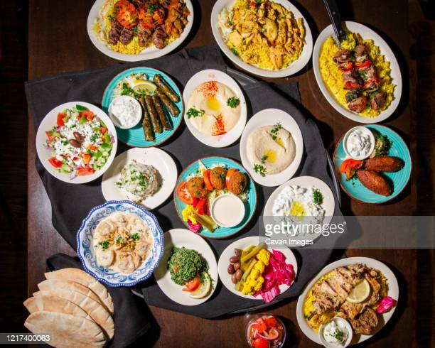 above-view of a meditterranean feast spread out on a table - dolmades stock pictures, royalty-free photos & images