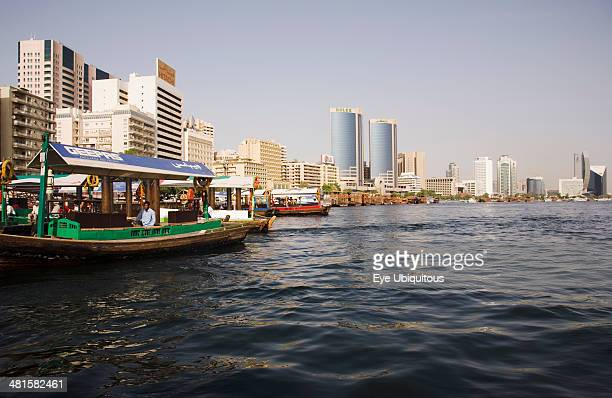 Abra water taxi moored on the Creek with Twin Towers shopping mall and skyline behind
