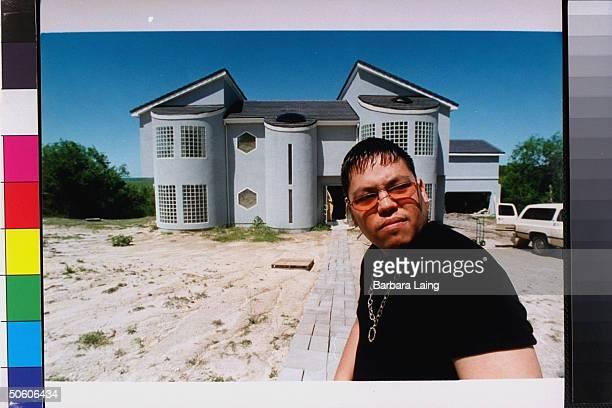 Abraham AB Quintanilla III bro of slain tejano singer Selena posing outside ultra modern house