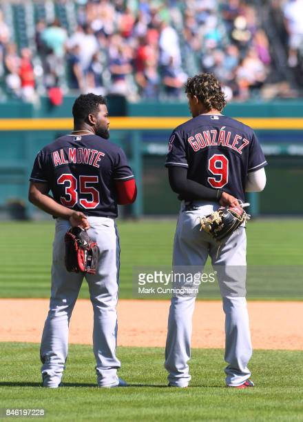 Abraham Almonte and Erik Gonzalez of the Cleveland Indians stand together on the field during the game against the Detroit Tigers at Comerica Park on...