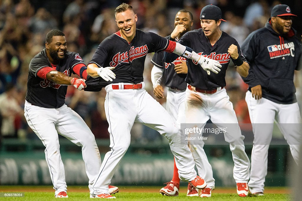 Abraham Almonte #35 of the Cleveland Indians celebrates with Brandon Guyer #6 and Tyler Naquin #30 after Guyer hit a walk-off RBI double to defeat the Kansas City Royals at Progressive Field on September 20, 2016 in Cleveland, Ohio. The Indians defeated the Royals 2-1.