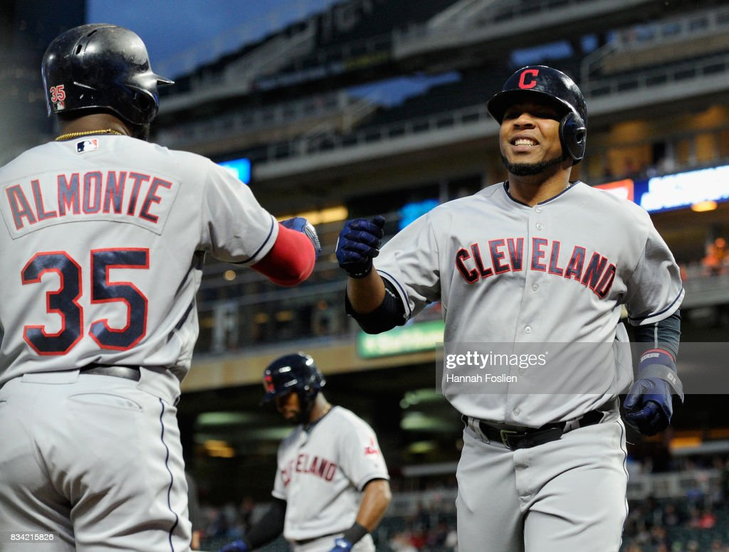 Abraham Almonte #35 of the Cleveland Indians congratulates teammate Edwin Encarnacion #10 on scoring a run against the Minnesota Twins during the seventh inning in game two of a doubleheader on August 17, 2017 at Target Field in Minneapolis, Minnesota. The Twins defeated the Indians 4-2.