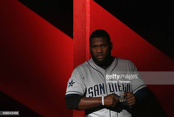 Abraham Almonte of the San Diego Padres in the dugout before the MLB game against the Arizona Diamondbacks at Chase Field on August 23 2014 in...