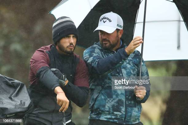 Abraham Ancer and Roberto Diaz of Mexico talk during day two of the 2018 World Cup of Golf at The Metropolitan on November 23 2018 in Melbourne...