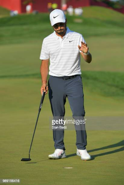 Abraham Ancer of Mexico acknowledges the gallery on the 18th hole during the final round of the Quicken Loans National at TPC Potomac at Avenel Farm...