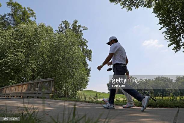 Abraham Ancer of Mexico and Francesco Molinari of Italy walk off the seventh tee during the final round of the Quicken Loans National at TPC Potomac...
