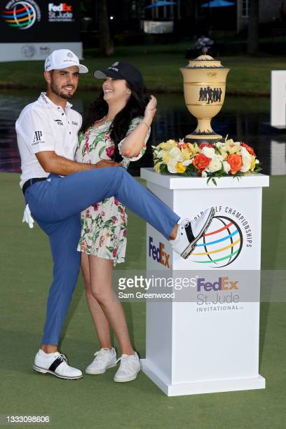 Abraham Ancer of Mexico and girlfriend Nicole Curtright pose with the trophy after Ancer won the FedEx St. Jude Invitational after the second playoff...