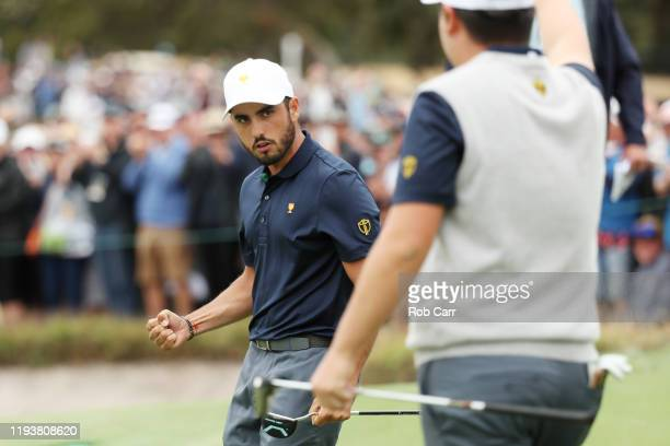 Abraham Ancer of Mexico and the International team and Sungjae Im of South Korea and the International team celebrate defeating Xander Schauffele of...