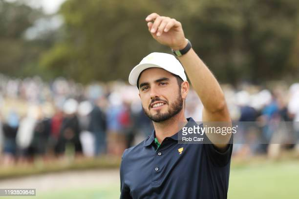 Abraham Ancer of Mexico and the International team celebrates after he and Sungjae Im of South Korea and the International team defeated Xander...