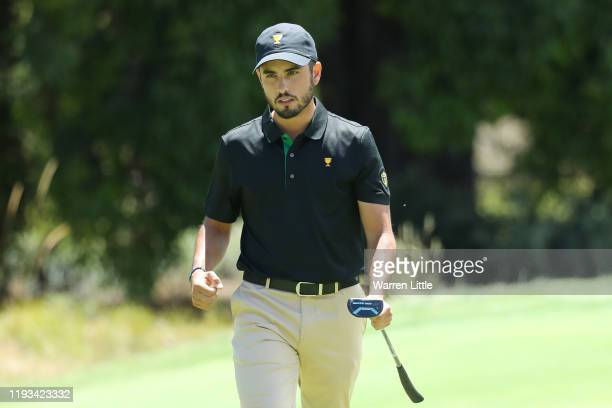 Abraham Ancer of Mexico and the International team reacts to his putt on the 13th green during Thursday fourball matches on day one of the 2019...
