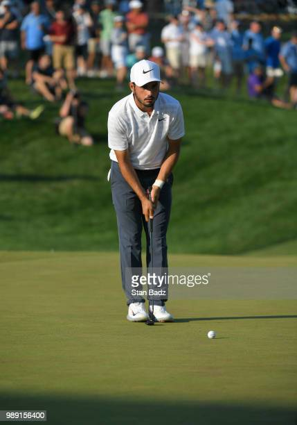 Abraham Ancer of Mexico checks his putt on the 18th hole during the final round of the Quicken Loans National at TPC Potomac at Avenel Farm on July 1...