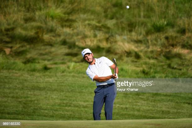 Abraham Ancer of Mexico chips a shot to the 15th hole green during the final round of the Quicken Loans National at TPC Potomac at Avenel Farm on...