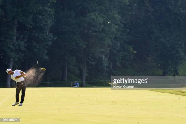 Abraham Ancer of Mexico hits a shot from the 11th hole fairway during the final round of the Quicken Loans National at TPC Potomac at Avenel Farm on...