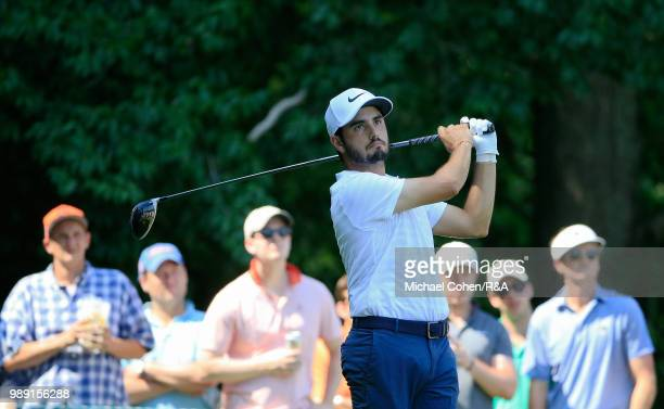 Abraham Ancer of Mexico hits his drive on the eighth hole during the fourth and final round of the Quicken Loans National held at TPC Potomac at...