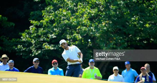 Abraham Ancer of Mexico hits his third shot on the eighth hole during the fourth and final round of the Quicken Loans National held at TPC Potomac at...
