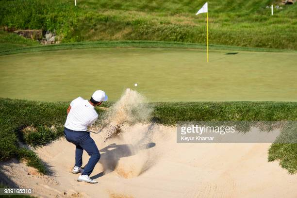 Abraham Ancer of Mexico hits out of a greenside bunker on 14th hole during the final round of the Quicken Loans National at TPC Potomac at Avenel...