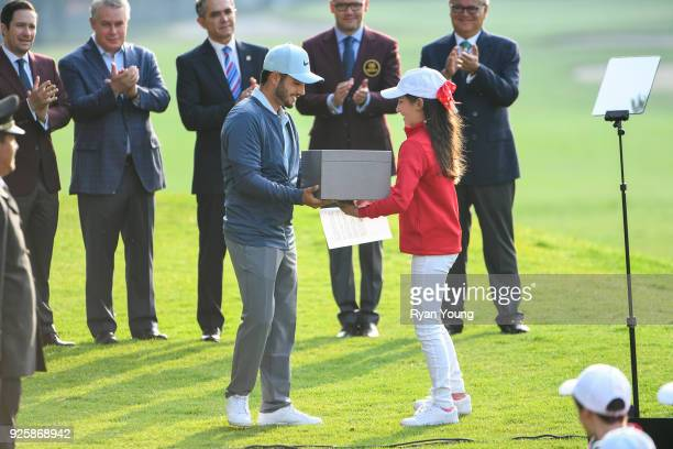 Abraham Ancer of Mexico is presented with a gift during opening ceremonies before round one of the World Golf ChampionshipsMexico Championship at...