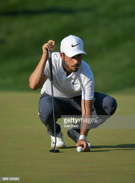 Abraham Ancer of Mexico lines his putt on the 18th hole during the final round of the Quicken Loans National at TPC Potomac at Avenel Farm on July 1...