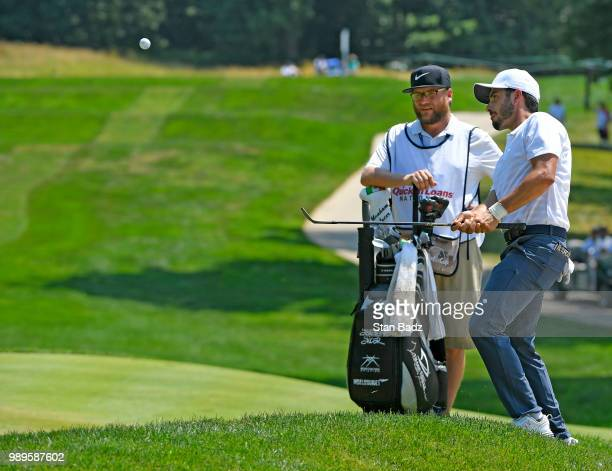 Abraham Ancer of Mexico plas a wedge shot on the third hole during the final round of the Quicken Loans National at TPC Potomac at Avenel Farm on...