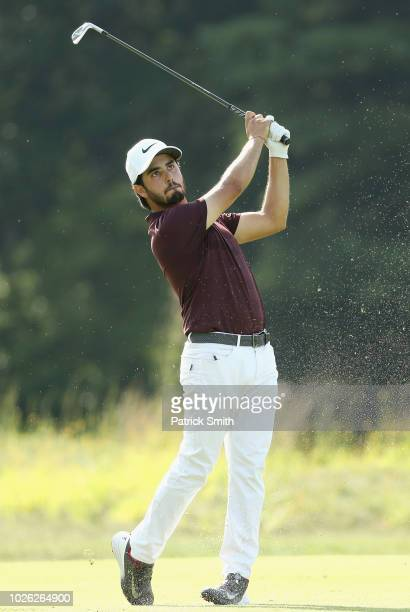Abraham Ancer of Mexico plays a shot on the 13th hole during round three of the Dell Technologies Championship at TPC Boston on September 2 2018 in...