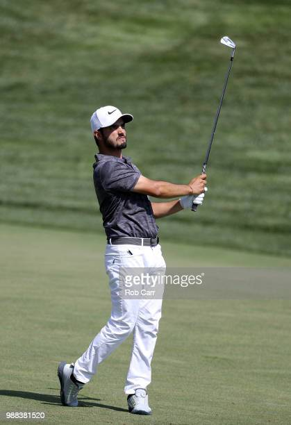 Abraham Ancer of Mexico plays a shot on the 16th hole during the third round of the Quicken Loans National at TPC Potomac on June 30 2018 in Potomac...