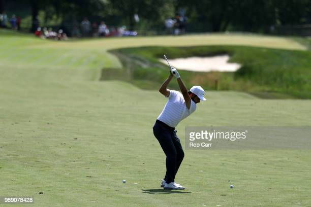 Abraham Ancer of Mexico plays a shot on the sixth hole during the final round of the Quicken Loans National at TPC Potomac on July 1 2018 in Potomac...