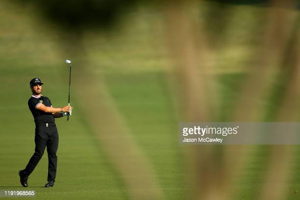 Abraham Ancer of Mexico plays an approach shot on the 12th hole during day one of the 2019 Australian Golf Open at The Australian Golf Club on...