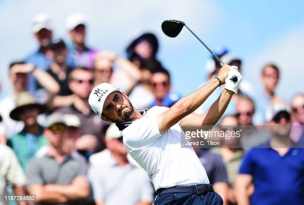 Abraham Ancer of Mexico plays his shot from the eighth tee during the third round of The Northern Trust at Liberty National Golf Club on August 10...