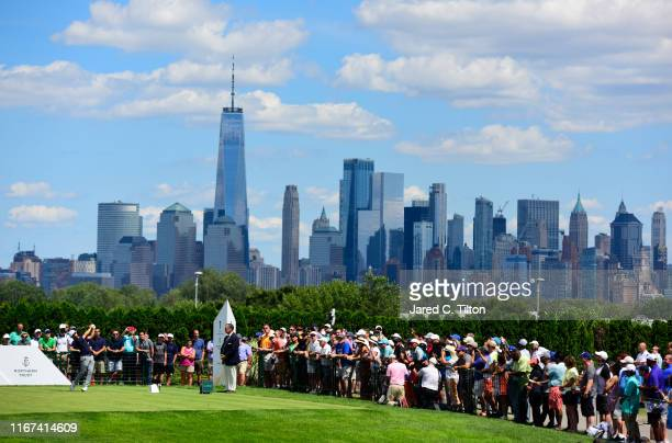 Abraham Ancer of Mexico plays his shot from the first tee during the final round of The Northern Trust at Liberty National Golf Club on August 11...