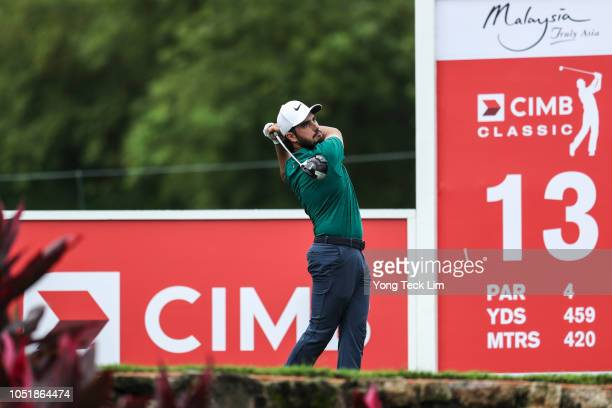 Abraham Ancer of Mexico plays his shot on the 13th tee during round one of the CIMB Classic at TPC Kuala Lumpur on October 11 2018 in Kuala Lumpur...