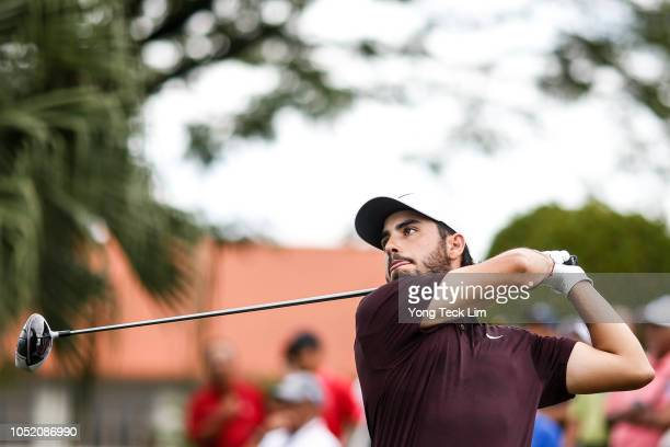 Abraham Ancer of Mexico plays his shot on the first tee during the final round of the CIMB Classic at TPC Kuala Lumpur on October 14 2018 in Kuala...