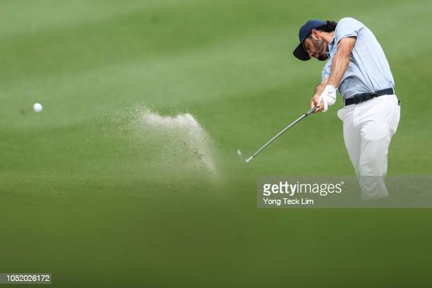 Abraham Ancer of Mexico plays his shot out of a bunker on the ninth green during round three of the CIMB Classic at TPC Kuala Lumpur on October 13...