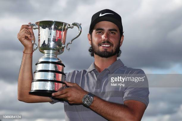 Abraham Ancer of Mexico poses with the Australian Open trophy during day four of the 2018 Australian Golf Open at The Lakes Golf Club on November 18...
